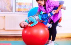 Rehabilitation through play - a boy undergoing playful rehabilitation with his physio