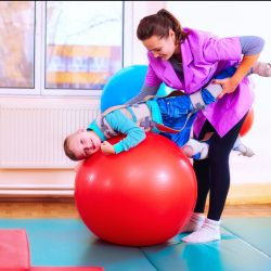 Rehabilitation through play - a boy undergoing playful rehabilitation with his physio