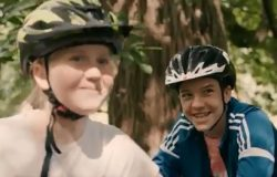 Smiling children with cycle helmets ahead of call for compulsory wear