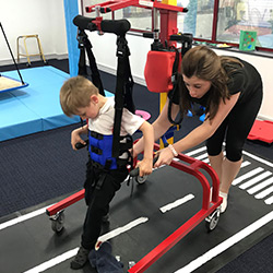 Theo has dystonic cerebral palsy and is seen here undergoing rehabilitation with Neurokinex