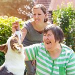 A lady with a mild traumatic brain injury enjoys the beauty of her garden in the summer, showcasing our Understanding mild traumatic brain injuries and their seriousness webinar