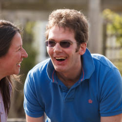 A gentleman with a subtle brain injury does the gardening with his wife