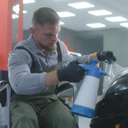 A brain injured man returning to work in a car body shop after brain injury
