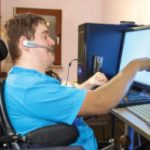 A brain injured person utilising assistive technology advertising our Google Euphonia webinar