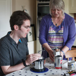 A man with an acquired brain injury making coffee as part of breakfast illustrating the role of nutrition to people who have brain injuries