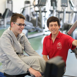 Liam (who has a brain injury) enjoying his brain injury rehabilitation plan at the gym with his personal trainer