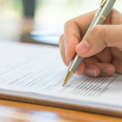 A person signing a document illustrating our Forensic accounting - claims for the self employed webinar