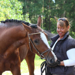 Mary with one of her horses illustrating Mary's story of tailored rehabilitation with case management services