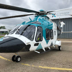 A helicopter from the Kent, Surrey and Sussex Air Ambulance illustrating paying it forward to emergency air ambulance through a personal injury claim.