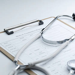 A stethoscope and notes board illustrate our clinical negligence claims FAQ